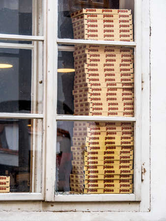 local supply: in a pizzeria choices for pizza awaiting extradition.