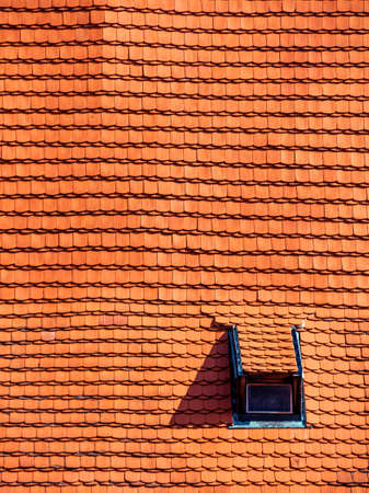 immobilien: roof with old tiles and gaupenfenster Stock Photo