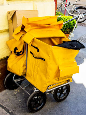communication occupation: bag of a postman. the postman distributes post