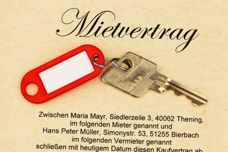accommodation broker: the key of an apartment and a lease in german Stock Photo