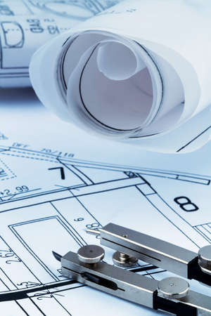 construction draftsman: an architects blueprint for the construction of a new residential building. symbol photo for funding and planning of a new house.