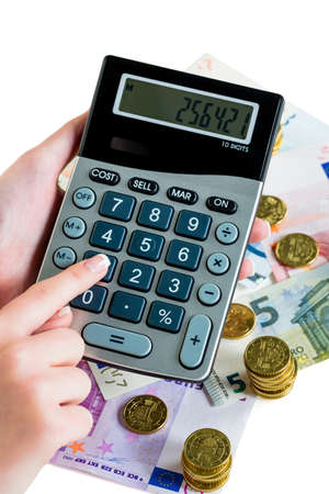 accounted for: hand with calculator and bills. symbol photo for revenue, profit, tax and calculation Stock Photo