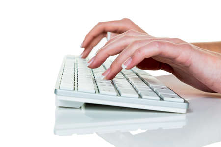 grope: a woman working in an office on the keyboard of a computer