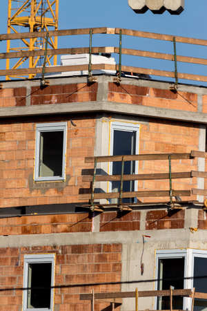 construction of a house for multiple tenants. urban housing in the city. Stock Photo