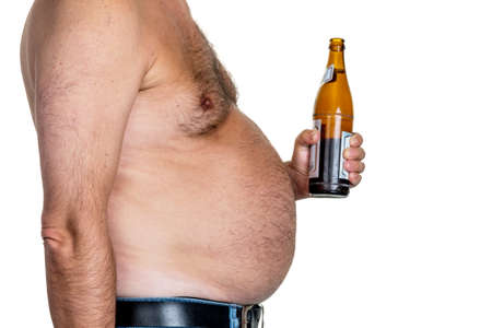 constrict: man with overweight. symbol photo for beer belly, unsuccessful dieting and poor nutrition