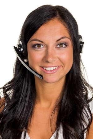 Een jonge vrouw in een mcc belde klanten met een headset