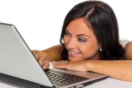 a young woman with a laptop computer. symbol photo for communication and modern media.