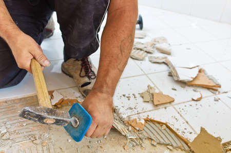 neighborly: the renovation uind renovation of a bathroom by a construction worker Stock Photo