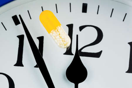 timekeeping: capsule on a watch, symbol photo for healthcare, healthcare reform, reform deadlock Stock Photo