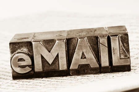 edv: the word e-mail in lead letters written. symbol photo for quick correspondence Stock Photo