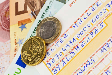 deposit: a payment slip for transfer with iban number and bic code in germany. Stock Photo