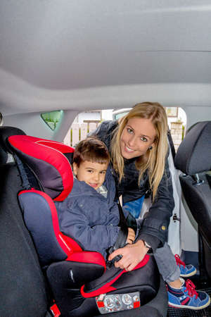 solicitous: boy in car seat, symbol of protection, care, vehicle safety