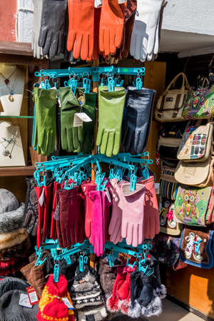 fingerling: in a business colorful gloves hanging for sale Stock Photo
