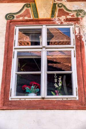 rehabilitated: a window in the czech town of cesky krumlov