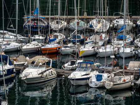 a port, waiting in the sailboats on their exit Stock Photo
