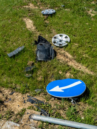 fully comprehensive: in a car accident traffic signs were converted exit at a roundabout Stock Photo
