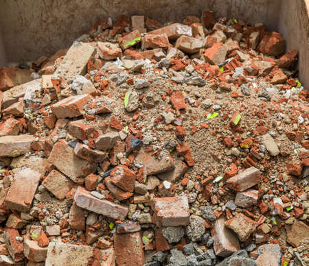 refurbishing: rubble in a container. renovating and refurbishing of housing.