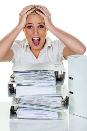 listless: young woman in office is overwhelmed with work. burnout at work or study.