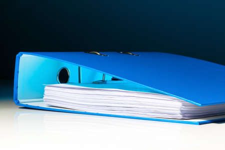 folder with documents: file folder with documents and documents. retention of contracts. Stock Photo