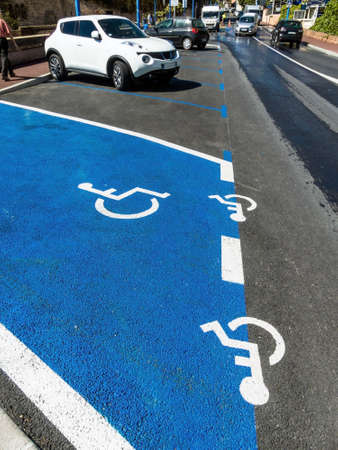 wheelchair users: parking for wheelchairs. handicapped parking in a city.