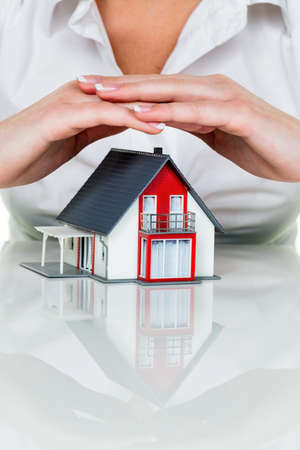single familiy: a woman protects your house and home. good insurance and reputable financing calm.