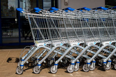 grocers: in front of a supermarket shopping carts are available for customers