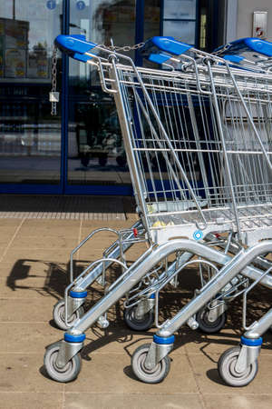 local supply: in front of a supermarket shopping carts are available for customers