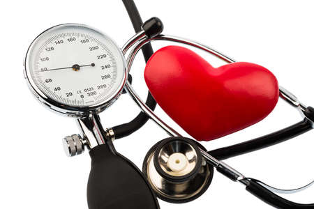 pracitioner: a sphygmomanometer, a heart and stethoscope lying on a white ground