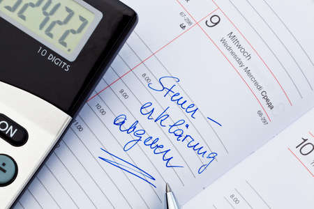 auditors: an appointment is entered on a calendar: tax return Stock Photo