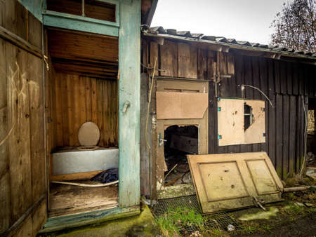 incontinence: toilet outdoors in a old, abandoned house.