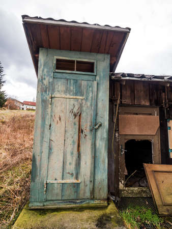 bowel movement: toilet outdoors in a old, abandoned house.