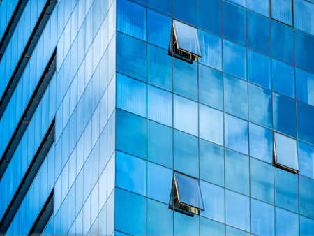 immobilien: in a modern office building, a window is opened.