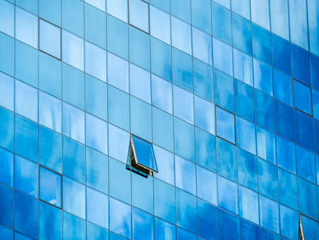 ventilate: in a modern office building, a window is opened.
