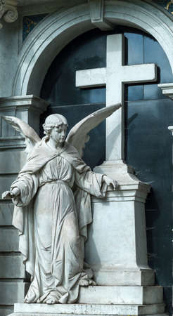 angel cemetery: a guardian angel on a grave in a cemetery