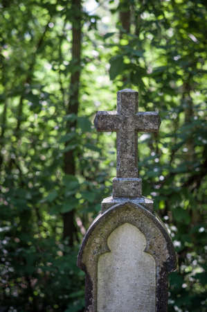 inri: a stone cross in a cemetery. peace and memory of the deceased.