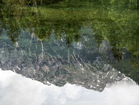 relaxen: austria, upper austria, schiederweiher. mountain reflected in lake. in the reflection you see on the bottom of the lake Stock Photo