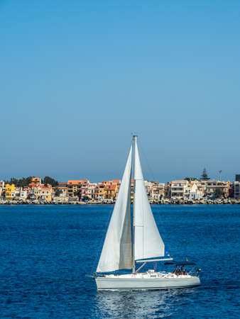at sea a sailboat floating with sails.