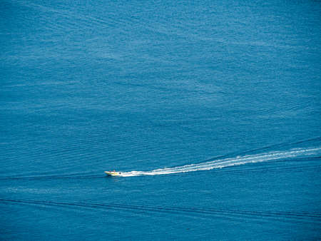 a motorboat floating on the sea.