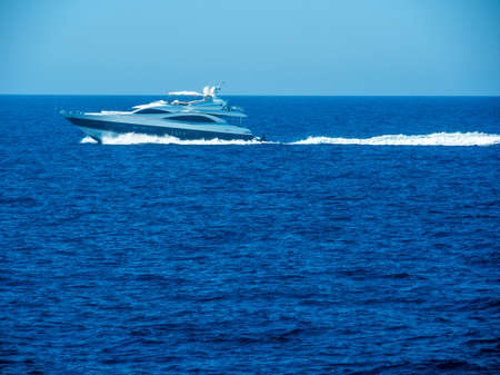 privileged: a motorboat floating on the sea.