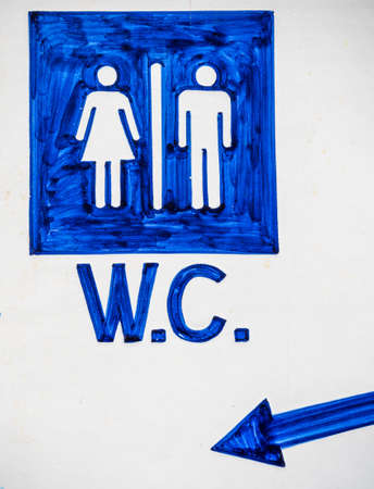 bowel movement: sign to the entrance of a toilet for men and women