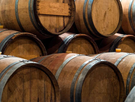 nfor a winery standing barrels with wine in wine cellar. Stock Photo