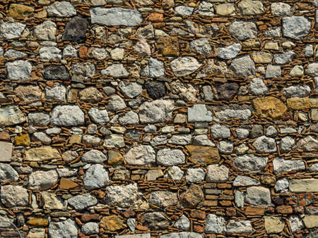 dissimilarity: an old stone wall in taormina, sicily, italy.