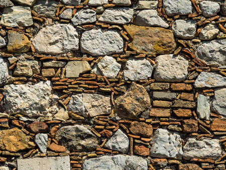 an old stone wall in taormina, sicily, italy.
