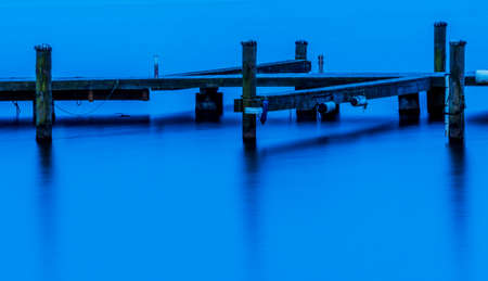 relaxen: austria, upper austria, gmunden, traunsee. dock for boats in a lake
