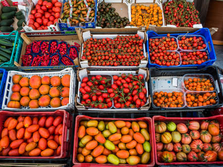 naturally: in a small italian town, a fruit and vegetable store. many different types of tomato Stock Photo
