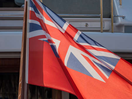 in the port of bareclona in spain are yachts. they fly the flag of the cayman islands Banco de Imagens