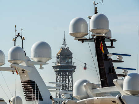 the cable car in the port of barcelona, ??spain. im foreground radar balls of yachts. Stock Photo