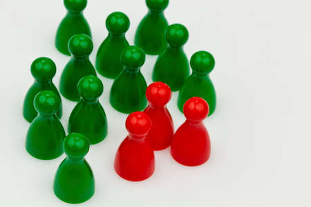 quota: red and green pawns. unlike in the team. quota for women in the workplace.