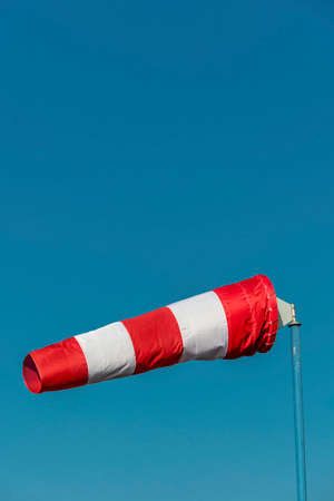 a windsock inflated by the wind. symbol photo for power and success