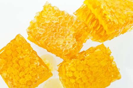 honeycomb against white background. honey to sweeten.